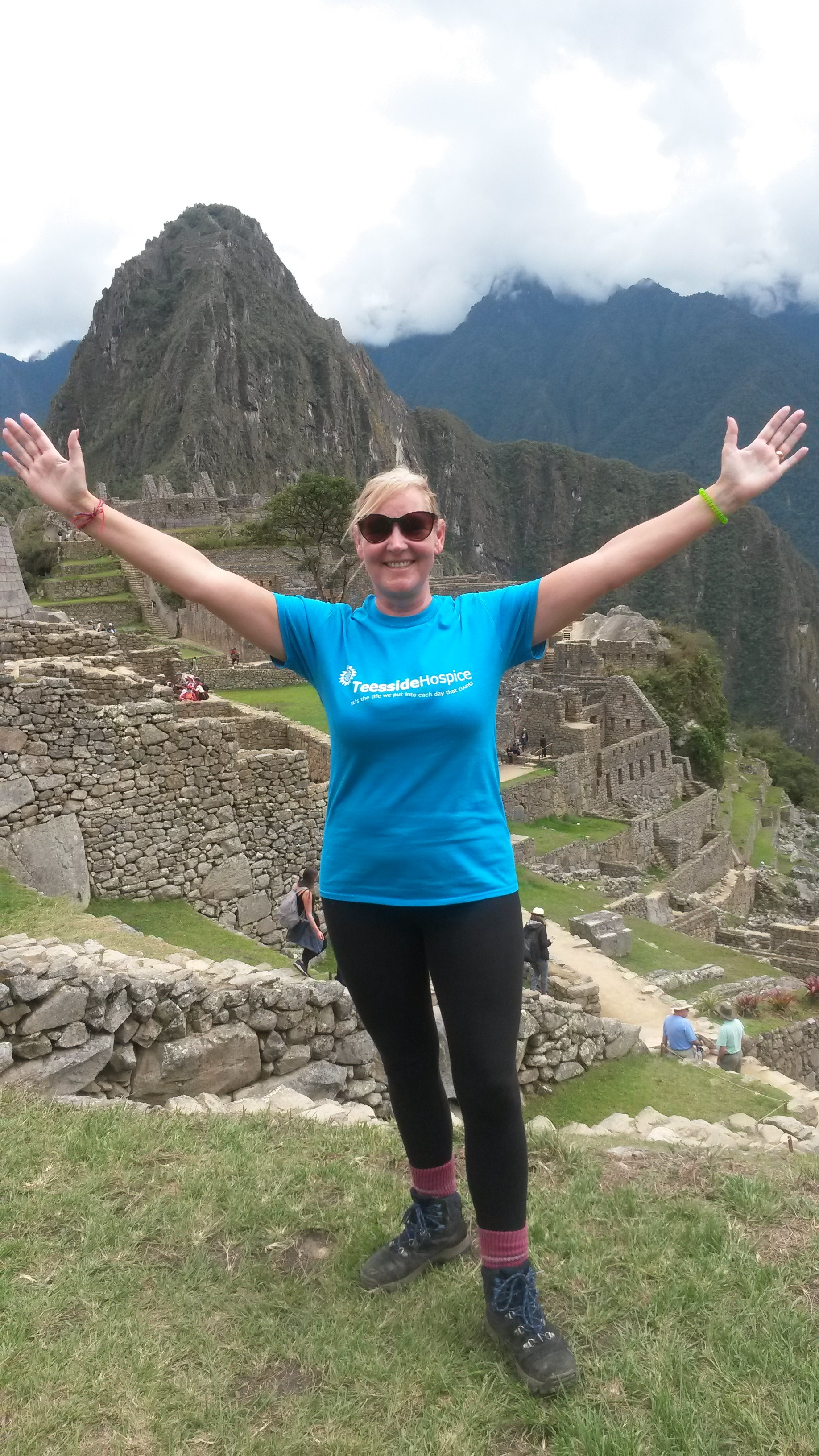Julie Woodier victorious after completing her Machu Picchu trek.